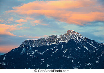 orange afterglow clouds over tirol mountain at winter