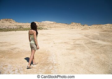 sensual woman walking at the desert - desert of Bardenas...