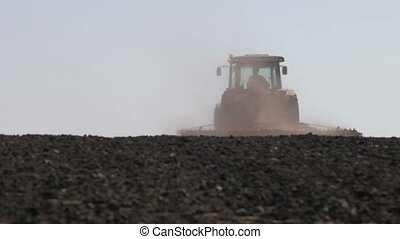 tractor plowing as much dust and leaves worth