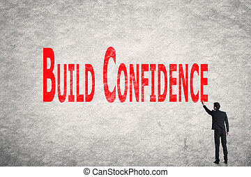 write words on wall, Build Confidence - Asian business man...