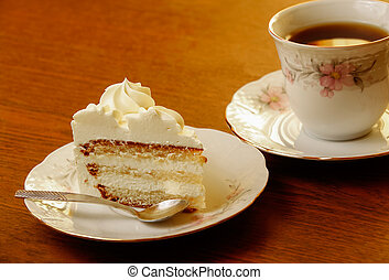 sweet cake with cup of tea on wooden background