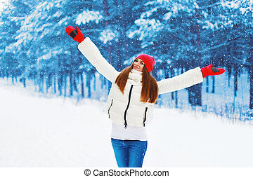 Winter and people concept - pretty woman rejoices winter...