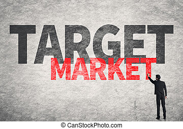 Target Market - Asian business man write words on wall,...