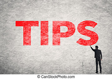 Tips - Asian business man write words on wall, Tips