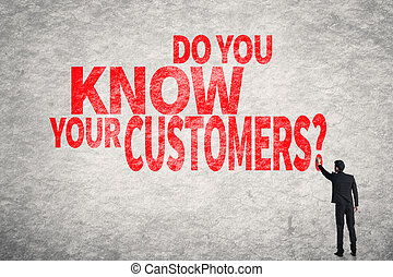 Do you Know your Customers - Asian business man write words...
