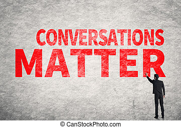 Conversations Matter - Asian business man write words on...