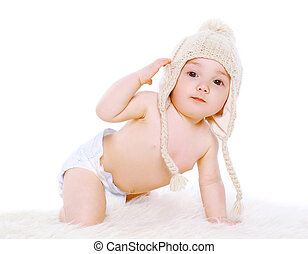 Funny baby in knitted winter hat