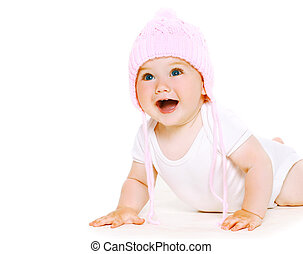 Funny baby in knitted hat playing