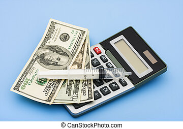 Calculating Healthcare Costs - A calculator with cash and a...