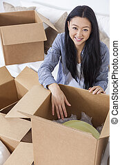 Asian Woman Girl Unpacking Boxes Moving House - Asian...