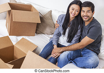 Asian Chinese Couple Unpacking Boxes Moving House - Asian...