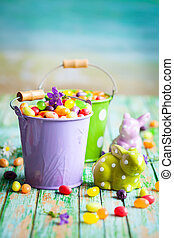 Easter rabbits and candy - Easter rabbits and buckets with...