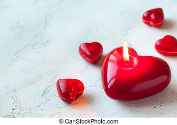 Red hearts - Heart shaped candle and sweet candy for...