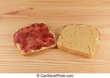 Slices of fresh bread with jelly and peanut butter - Slices...
