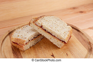 Two homemade peanut butter and jam sandwiches - Two homemade...