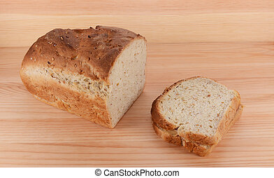 Cut loaf of freshly baked bread with a PB&J sandwich - Cut...