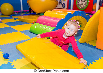Happy child girl on playground. The concept of childhood and...
