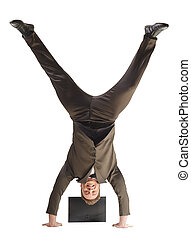 Smiling businessman standing on hands