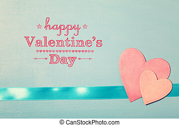 Happy Valentines Day message with pink paper hearts