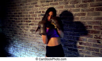 Young sexy woman boxing.
