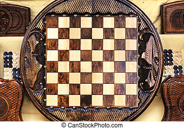 chessboard - Checkerboard of the round shape made of wood...