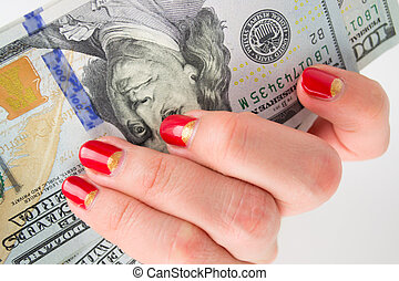 girl with red manicure gives money. denominations hundred...
