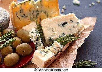 Roquefort cheese composition on dark background
