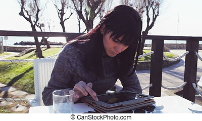 Girl writing email with tablet - Happy woman having good...