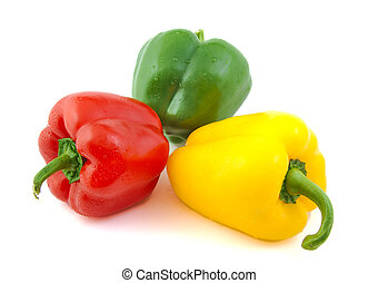 Close up of green, red and yellow fresh peppers on white...
