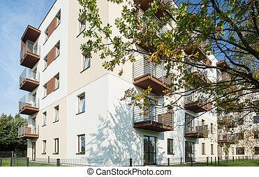 Housing development - White residential block in new...