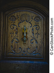 Entrance, old wooden door with carvings
