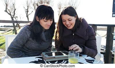 Two beautiful women having fun with - Happy girlfriends...