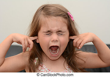 Screaming child girl age 05 face concept photo of stress and...