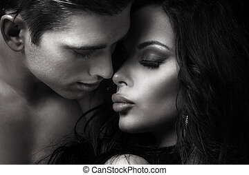 Beautiful couple kissing - Emotional portrait of attractive...
