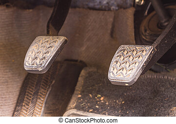 Brake pedal and accelerator in a car