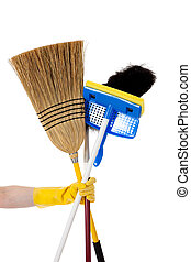 Housework - Broom, mop, duster - A gloved yellow hand...