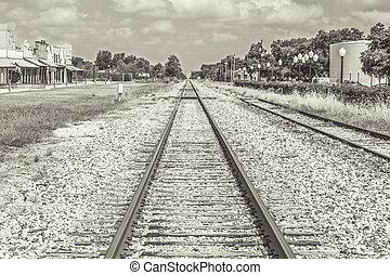 Railroad Tracks Sephia Tone - A rural scene of railroad...