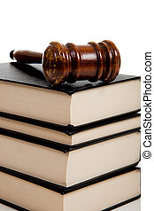 Wooden gavel on top of a stack of law books - A wooden...