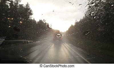 Driving the Car Through Heavy Rain Point of View Windshield...