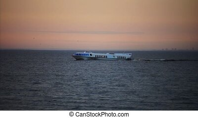 Tourist ship in sunset light, slow motion - Slow motion...