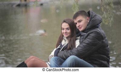 loving couple embracing sitting