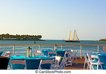 Sunset at Key West waterfront A sea view of dining area with...