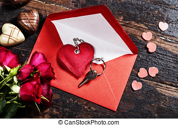 Valentine's day composition - Red envelop, roses, chocolate...