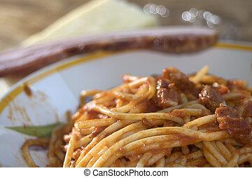 pasta allamatriciana - tasty Italian speciality: spaghetti...