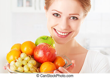 happy girl and healthy vegetarian food, fruit - happy young...