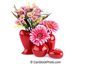 Flowers in vases and glass heart isolated on white...