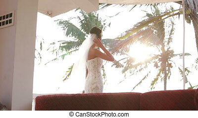 beautiful bride in wedding dress - Bride back straightened...