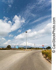 asphalt Road in the industrial area, Sardinia, Italy