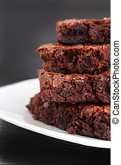 Brownies - Pile of chocolate fudge brownies on a plate with...