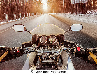 Biker First-person view Winter slippery road - Biker rides...